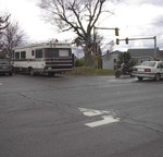 Photo of our 1987 Rockwood and motorcycle in the far corner of Elliot Hospital parking lot 14