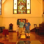 "Lynn and Art, picture taken for us by interim minister David Boyer.  Sent in to the Advocate's A Day in Gay America with a caption mentioning our employment by UUCM.  The Advocate's fact checking person was told by the UUCM office administrator Deborah Ross that ""We don't want our name mentioned in a gay magazine."""